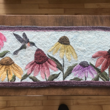 """An original design hooked by Linda Connolly, Dartmouth NS, photographed by Neville Connolly, completed in 2021, 37"""" x 16"""""""